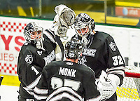 29 December 2014: Providence College Friar Goaltender Jon Gillies (32), a Junior from South Portland, Maine, is congratulated by fellow Goaltender Brendan Leahy (1), a Sophomore from Reading, MA, after a game against the University of Vermont Catamounts during the deciding game of the annual TD Bank-Sheraton Catamount Cup Tournament at Gutterson Fieldhouse in Burlington, Vermont. Gillies and the Friars shut out the Catamounts 3-0 to win the 2014 Cup. Mandatory Credit: Ed Wolfstein Photo *** RAW (NEF) Image File Available ***