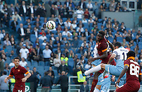 Calcio, Serie A: Lazio vs Roma. Roma, stadio Olimpico, 25 maggio 2015.<br /> Roma's Mapou Yanga-Mbiwa, third from right, heads to score the winning goal during the Italian Serie A football match between Lazio and Roma at Rome's Olympic stadium, 25 May 2015. Roma won 2-1.<br /> UPDATE IMAGES PRESS/Riccardo De Luca