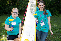 """Lauren Shafer, left, and Kia Adams pose for a photo during """"Circle the City with Service,"""" the Kiwanis Circle K International's 2015 Large Scale Service Project, on Wednesday, June 24, 2015, at the Friendship Westside Center for Excellence in Indianapolis. (Photo by James Brosher)"""