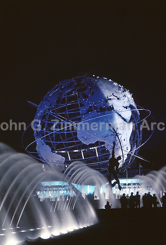 Visitors stand in front of the Unisphere, 1964 World's Fair, Flushing Meadows, New York. Photo by John G. Zimmerman.
