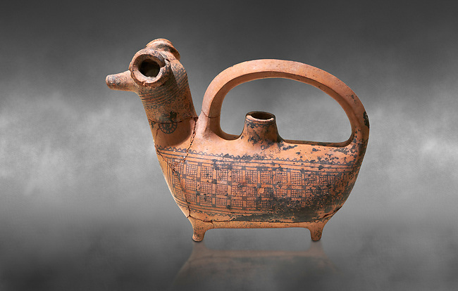Phrygian decorated  terra cotta pottery  rhyton in the shape of a ram from Gordion. Phrygian Collection, 8th century BC - Museum of Anatolian Civilisations Ankara. Turkey. Against a grey background