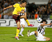 Arsenal player Marouane Chamakh, left blocked by Partizan player Stefan Savic, right,  during  UEFA Champions league match in group H FC Partizan Belgrade Vs. Arsenal, London, Serbia, Monday, Sept. 28, 2010.  (Srdjan Stevanovic/Starsportphoto.com)