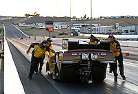Jul. 26, 2013; Sonoma, CA, USA: NHRA Safety Safari members push funny car driver Jeff Arend back to the starting line after failing to get the car into reverse during qualifying for the Sonoma Nationals at Sonoma Raceway. Mandatory Credit: Mark J. Rebilas-