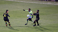 COLUMBUS, OH - DECEMBER 12: Joevin Jones #33 of the Seattle Sounders FC is defended by Derrick Etienne Jr #22 and Lucas Zelarayan #10 of the Columbus Crew during a game between Seattle Sounders FC and Columbus Crew at MAPFRE Stadium on December 12, 2020 in Columbus, Ohio.
