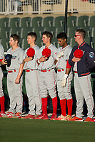 Mickey Moniak (center) stands for the National Anthem with his teammates prior to the game against the Kannapolis Intimidators at Kannapolis Intimidators Stadium on April 8, 2017 in Kannapolis, North Carolina.  The BlueClaws defeated the Intimidators 8-4 in 10 innings.  (Brian Westerholt/Four Seam Images)