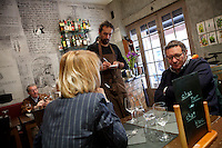 Nicolas Sikic takes an order at restaurant 'Chat Noir, Chat Blanc', Nice, France, 10 April 2012