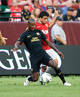 Rafael (21) of Manchester United fights for for the ball with Eric Abidal (22) of Barcelona during the friendly at FedEX Field in Landover, MD.  Manchester United defeated FC Barcelona, 2-1.