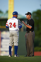 Lexington Legends manager Omar Ramirez (24) argues a call with umpire Grant Conrad during a game against the Hagerstown Suns on May 22, 2015 at Whitaker Bank Ballpark in Lexington, Kentucky.  Lexington defeated Hagerstown 5-1.  (Mike Janes/Four Seam Images)