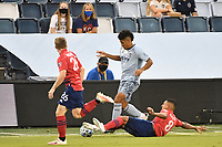 KANSAS CITY, KS - SEPTEMBER 02: Jaylin Lindsey #26 of Sporting Kansas City tackled by Bryan Acosta #8 of FC Dallas during a game between FC Dallas and Sporting Kansas City at Children's Mercy Park on September 02, 2020 in Kansas City, Kansas.