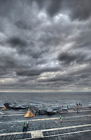 F/A-18 Hornets are readied for launch on the waist catapults aboard USS Carl Vinson (CVN 70).