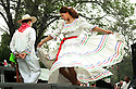 "Elsa Enamorado and Oscar Reyes dance the Honduras folkloric dance ""Jarabe Lloreno"" at the Independence Day festival."