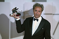 """Director Paolo Sorrentino poses with the Silver Lion Grand Jury Prize for """"The Hand Of God"""" during the Winners Red Carpet as part of the 78th Venice International Film Festival in Venice, Italy on September 11, 2021. <br /> CAP/MPI/IS/PAC<br /> ©PAP/IS/MPI/Capital Pictures"""
