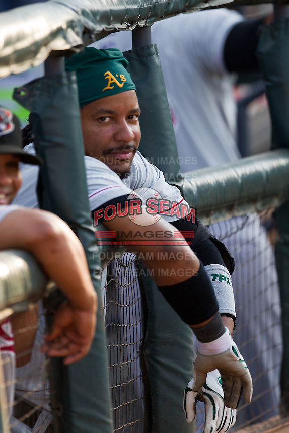 Sacramento River Cats designated hitter Manny Ramirez #11 watches the game from the dugout during the Pacific Coast League baseball game against the Round Rock Express on May 22, 2012 at The Dell Diamond in Round Rock, Texas. The Express defeated the River Cats 11-5. (Andrew Woolley/Four Seam Images).