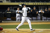Michael Wein (26) of the Wake Forest Demon Deacons follows through on his swing against the Sacred Heart Pioneers at David F. Couch Ballpark on February 15, 2019 in  Winston-Salem, North Carolina.  The Demon Deacons defeated the Pioneers 14-1. (Brian Westerholt/Four Seam Images)