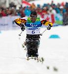 Lou Gibson, Vancouver 2010 - Para Nordic Skiing // Ski paranordique.<br /> Lou Gibsonn competes in Para Biathlon // Lou Gibson participe en parabiathlon. 13/03/2010.