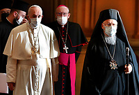 """Pope Francis and Orthodox Patriarch Bartholomew of Constantinople arrive for the meeting, """"Faith and Science: Towards COP26,"""" with religious leaders in the Apostolic Palace at the Vatican Oct. 4, 2021. The meeting was part of the run-up to the U.N. Climate Change Conference, called COP26, in Glasgow, Scotland, Oct. 31 to Nov. 12, 2021."""
