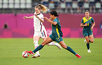 KASHIMA, JAPAN - JULY 27: Samantha Mewis #3 of the United States battles with  Mary Fowler #11 of Australia before a game between Australia and USWNT at Ibaraki Kashima Stadium on July 27, 2021 in Kashima, Japan.