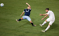 CARSON, CA - MARCH 07: Emiliano Insua #3 of the Los Angeles Galaxy takes a shot past Ryan Raposo #27 of the Vancouver Whitecaps during a game between Vancouver Whitecaps and Los Angeles Galaxy at Dignity Health Sports Park on March 07, 2020 in Carson, California.