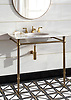 """Indus, a stone water jet mosaic, shown in tumbled Nero Marquina, honed Thassos, and brass with 12"""" X 24"""" polished Dolomite bricks and brass liners."""