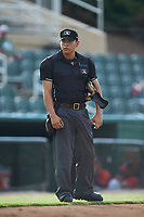 Home plate umpire Rene Gallegos between innings of the South Atlantic League game between the Lexington Legends and the Kannapolis Intimidators at Kannapolis Intimidators Stadium on August 4, 2019 in Kannapolis, North Carolina. The Legends defeated the Intimidators 5-1. (Brian Westerholt/Four Seam Images)