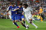 Real Madrid´s Marcelo Vieira (R) and Juventus´s Claudio Marchisio and Lichsteiner during the Champions League semi final soccer match between Real Madrid and Juventus at Santiago Bernabeu stadium in Madrid, Spain. May 13, 2015. (ALTERPHOTOS/Victor Blanco)