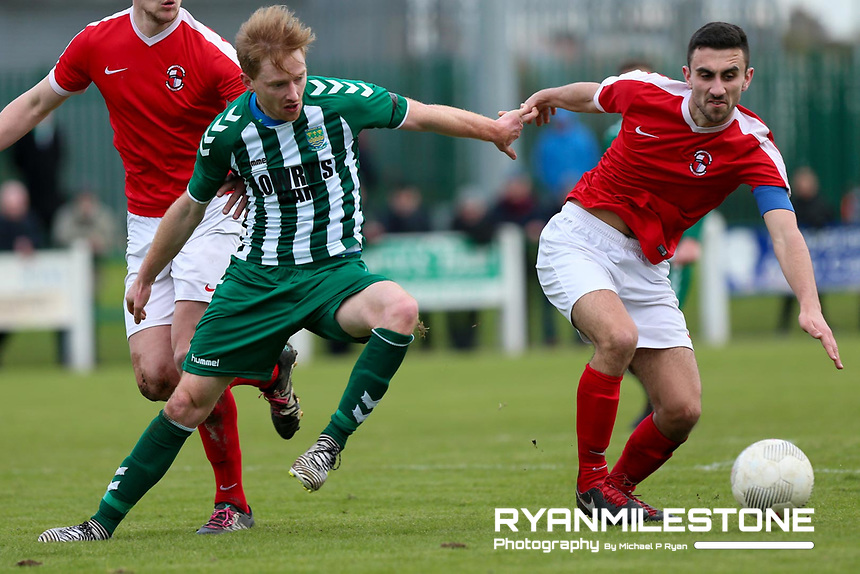 St Michael's John O' Brien in action against Sean Tierney of Tolka Rovers during the New Balance FAI Junior Cup 7th Round at Cooke Park ,Tipperary Town on Sunday 4th February 2018, Photo By Michael P Ryan