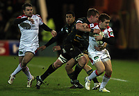 Friday 7th December 2012;  Paddy Jackson in action for Ulster is tackled by Saints Gerrit-Jan van Velze during the Pool 4 round 3 Heineken Cup clash at Franklin's Gardens, Northampton, England. Image credit -: JOHN DICKSON / DICKSONDIGITAL