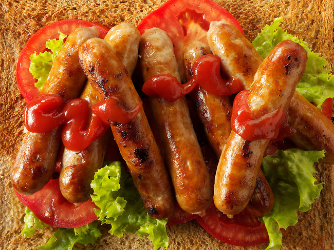 Traditional chipolatta pork sausages with tomato ketchup