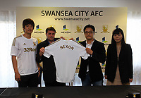 Friday 02 November 2012<br /> Pictured L-R: Footballer Ki Sung Yueng, vice chairman Leigh Dineen and representatives from Nexon.<br /> Re: Sponsorship deal between Korean gaming firm Nexon and Swansea City FC at the Liberty Stadium, south Wales.