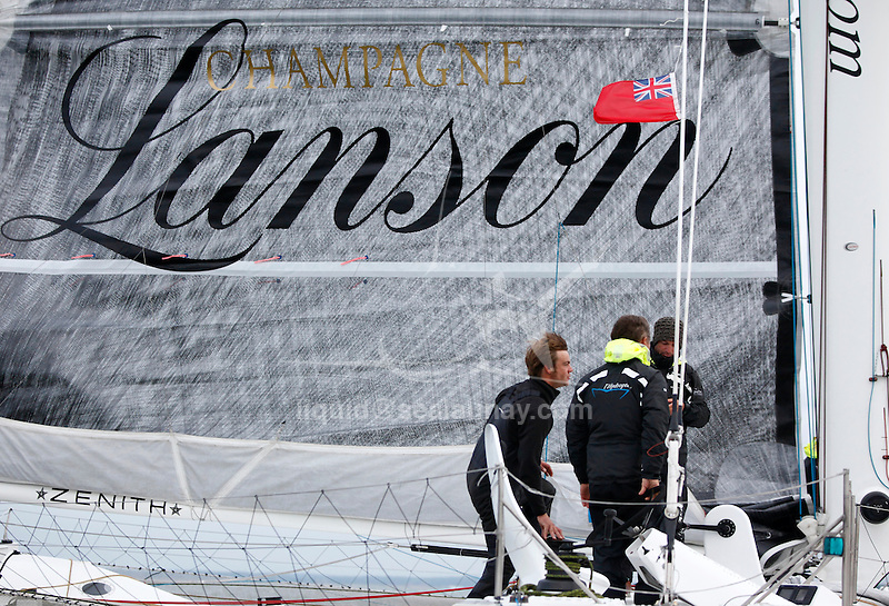 The Hydroptere at the start of a record attempt sailing in the Solent, Cowes, Isle of Wight, United Kingdom..Now the fastest sailing boat in the world with an average speed of 51.36 knots over 500 meters and 50.17 knots over one nautical mile, the flying trimaran is currently heading to the open sea.