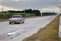 Cuba, Cienfuegos.  Traffic on Divided, Four-Lane Highway Linking Havana and Cienfuegos.  1950s Pontiac.