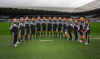 Pictured: Michael Laudrup (C) with coaching staff<br />