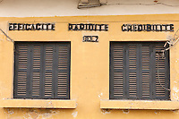 """Senegal, Saint Louis.  """"Efficiency, Rapidity, Credibility"""" on a Building from the French Colonial Era."""