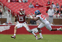 Arkansas quarterback Feleipe Franks (13) carries the ball as Ole Miss defensive lineman DeSanto Rollins (99) blocks, Saturday, October 17, 2020 during the second quarter of a football game at Donald W. Reynolds Razorback Stadium in Fayetteville. Check out nwaonline.com/201018Daily/ for today's photo gallery. <br /> (NWA Democrat-Gazette/Charlie Kaijo)
