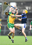 Eoin Fitzgerald of Inagh-Kilnamona in action against Conor Cahill of Kilmaley during their Minor A county final at Cusack Park. Photograph by John Kelly.
