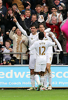 Sunday 06 January 2013<br /> Pictured: (L-R) Swansea City players Danny Graham, Nathan Dyer and Michu celebrating Michu's opening goal. <br /> Re: FA Cup third round, Swansea City FC v Arsenal at the Liberty Stadium, south Wales.
