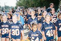 Young girls wear football jerseys while marching in the Labor Day parade in Milford, New Hampshire. Republican candidates John Kasich, Carly Fiorina, and Lindsey Graham, and Democratic candidate Bernie Sanders marched in the parade.