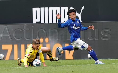16th May 2020, Signal Iduna Park, Dortmund, Germany; Bundesliga football, Borussia Dortmund versus FC Schalke;  Schalke's Weston McKennie loses possession to BVB Lukasz Piszczek