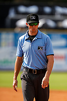 First base umpire Jonathon Benken makes his way to his position during the game between the Rocket City Trash Pandas and the Tennessee Smokies at Smokies Stadium on July 2, 2021, in Kodak, Tennessee. (Danny Parker/Four Seam Images)