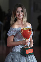 """Penelope Cruz poses with the Coppa Volpi for Best Actress for """"Parallel Mothers"""" during the Winners Red Carpet as part of the 78th Venice International Film Festival in Venice, Italy on September 11, 2021. <br /> CAP/MPI/IS/PAC<br /> ©PAP/IS/MPI/Capital Pictures"""