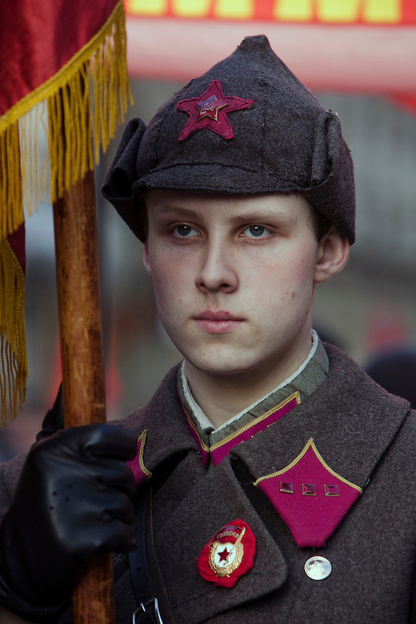 Moscow, Russia, 07/11/2010..A young man dressed in Red Guard uniform as members and supporters of the Russian Communist Party demonstrate to celebrate the 83rd anniversary of the October 1917 Bolshevik revolution. Russia no longer officially celebrates the anniversary of the 1917 Revolution that brought Vladimir Lenin to power and established communist rule in Russia and the Soviet Union over seven decades.