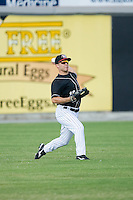 Center fielder Keanon Simon (12) of the Hickory Crawdads throws the ball back to the infield at L.P. Frans Stadium in Hickory, NC, Sunday, August 17, 2008.