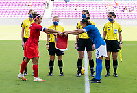 ORLANDO, FL - FEBRUARY 24: Desiree Scott #11 of Canada exchanges a banner with Marta #10 of Brazil before a game between Brazil and Canada at Exploria Stadium on February 24, 2021 in Orlando, Florida.