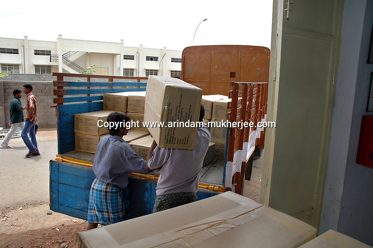 Trucks are being loaded with finished garments at Popy's  garment stitching factory in Tirupur, Tamilnadu. After lifting of quota system in textile export on 1st january 2005. Tirupur has become the biggest foreign currency earning town of India.