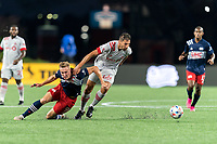 FOXBOROUGH, MA - JULY 7: Matt Turner #30 of New England Revolution and Omar Gonzalez #44 of Toronto FC battle for the ball during a game between Toronto FC and New England Revolution at Gillette Stadium on July 7, 2021 in Foxborough, Massachusetts.