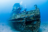 Diver exploring the wreck of the M/V Corinthian, a tugboat, St. Kitts, Caribbean.