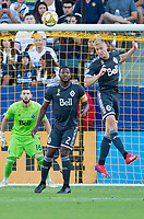 CARSON, CA - SEPTEMBER 29: Andy Rose #15 of the Vancouver Whitecaps heads a ball during a game between Vancouver Whitecaps and Los Angeles Galaxy at Dignity Health Sports Park on September 29, 2019 in Carson, California.