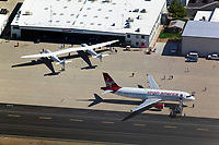 aerial photograph of Virgin Galactic White Knight Two at the Mojave Air and Spaceport (MHV), Mojave, Kern County,  California with a Virgin America Airbus A320.