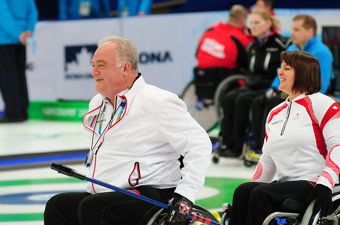 Jim Armstrong and Ina Forrest, Vancouver 2010 - Wheelchair Curling // Curling en fauteuil roulant.<br /> Team Canada competes in Wheelchair Curling // Équipe Canada participe en curling en fauteuil roulant. 13/03/2010.