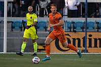 SAN JOSE, CA - JULY 24: Tim Parker #5 of the Houston Dynamo looks up to pass the ball during a game between San Jose Earthquakes and Houston Dynamo at PayPal Park on July 24, 2021 in San Jose, California.